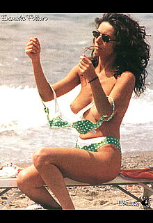 Emanuela Folliero changing on a beach shows her nude tits