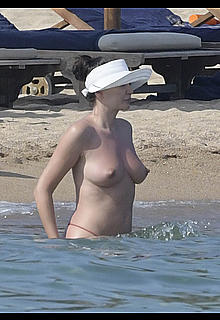 Bleona Qereti nude tits and round ass on the beach in Sardinia