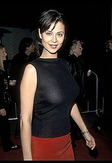 Catherine Bell braless shows hard nipples in a see through top at Edtv premiere