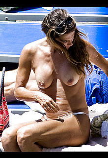 Fiona Swarovski changing on a beahc flashing her nude tits and pussy