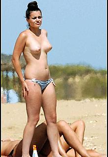 Spanish actress Adriana Torrebejano topless on a beach paparazzi photos