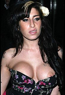 Amy Winehouse boob slip in London paparazzi photos