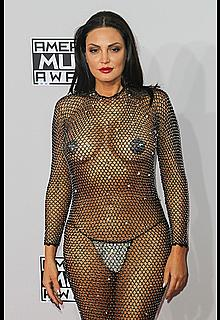 Bleona Qeretiin in see through mesh dress with pasties at The 42nd Annual American Music Awards