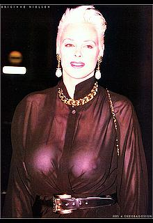 Danish actress Brigitte Nielsen braless in see through dress