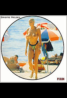 Danish actress, model, singer and reality television personality Brigitte Nielsen topless on a beach