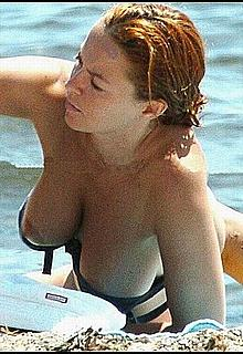 Carolina Ferre boob slip on a beach paparazzi photos