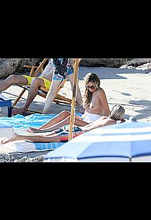 Heidi Klum sunbathing topless in Capri