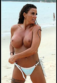 Busty Katie Price topless on a beach with boyfriend in Thailand