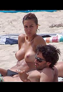Spanish actress and former model Megan Montaner topless on a beach