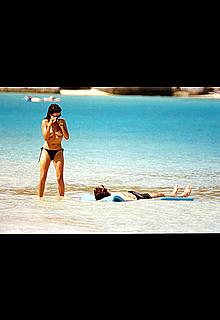 Spanish actress Penelope Cruz topless at a beach with camera in Virgin Islands