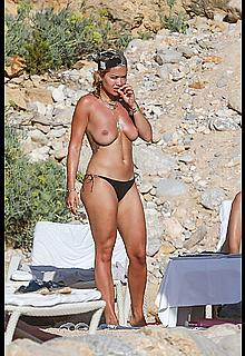 Rita Ora topless with friends on holiday in Ibiza