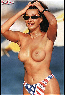 Italian Luisa Corna topless on a beach