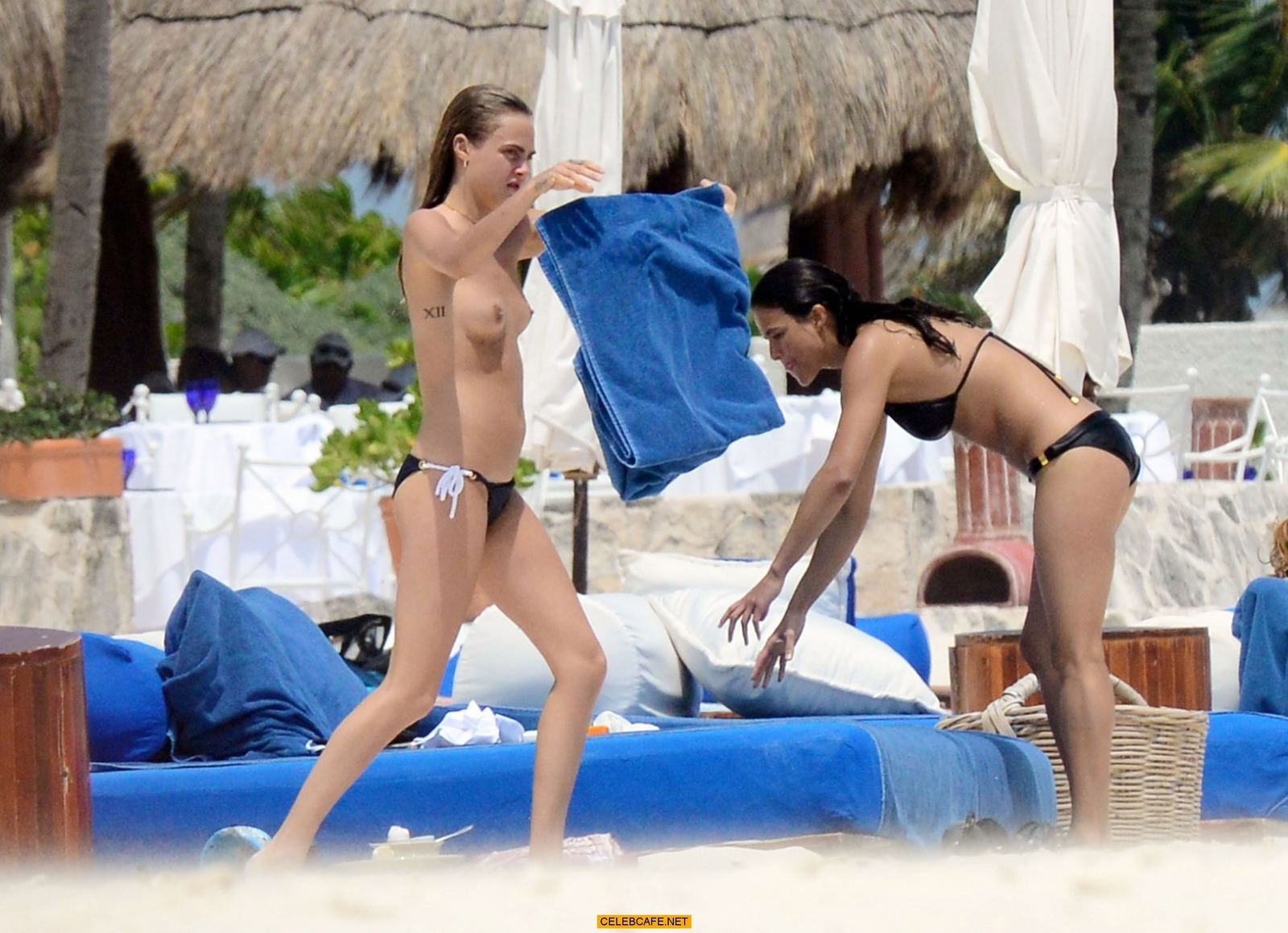 Cara Delevingne topless and Michelle Rodriguez in bikini on a Beach in ...