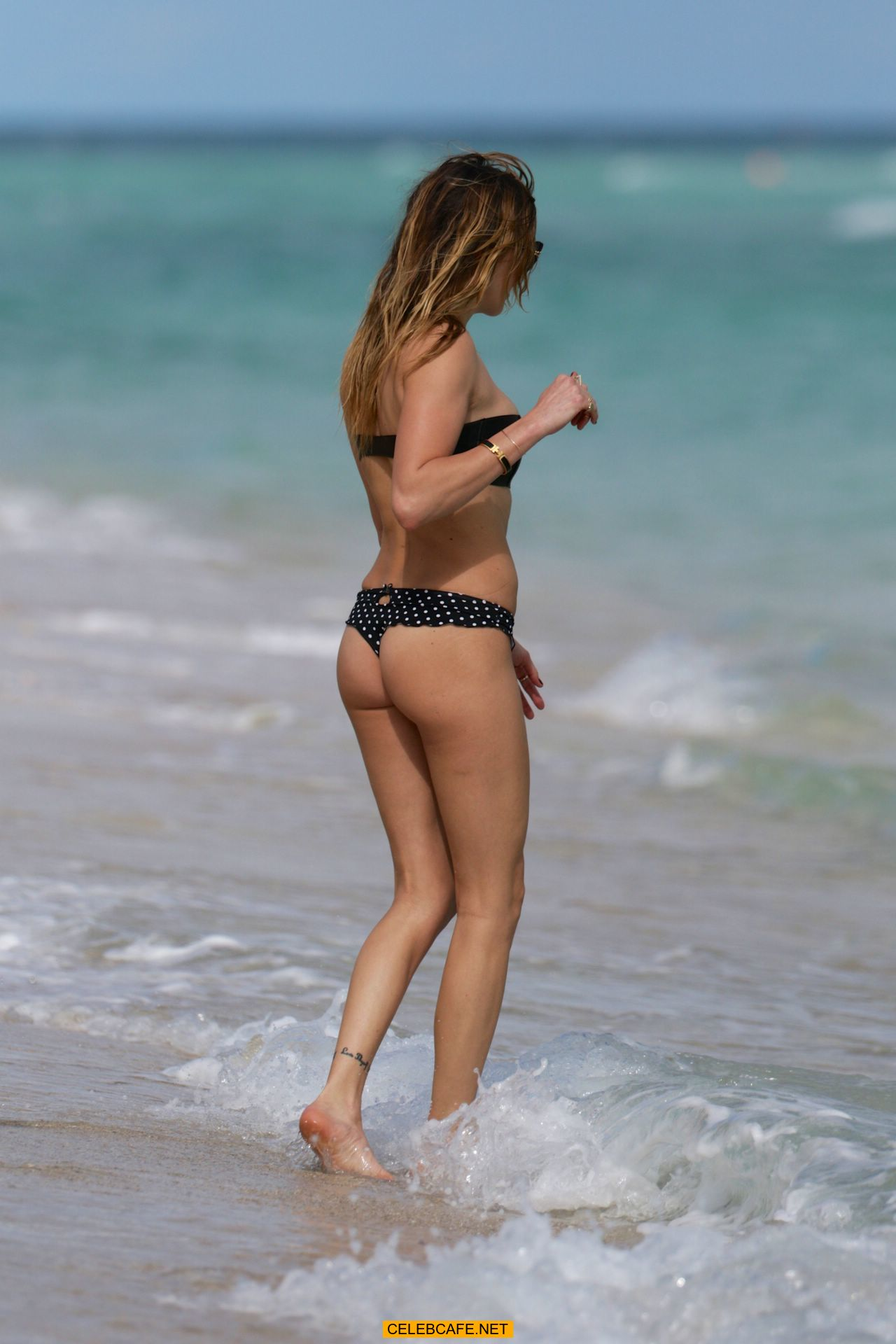 katie cassidy wearing black bikini in miami