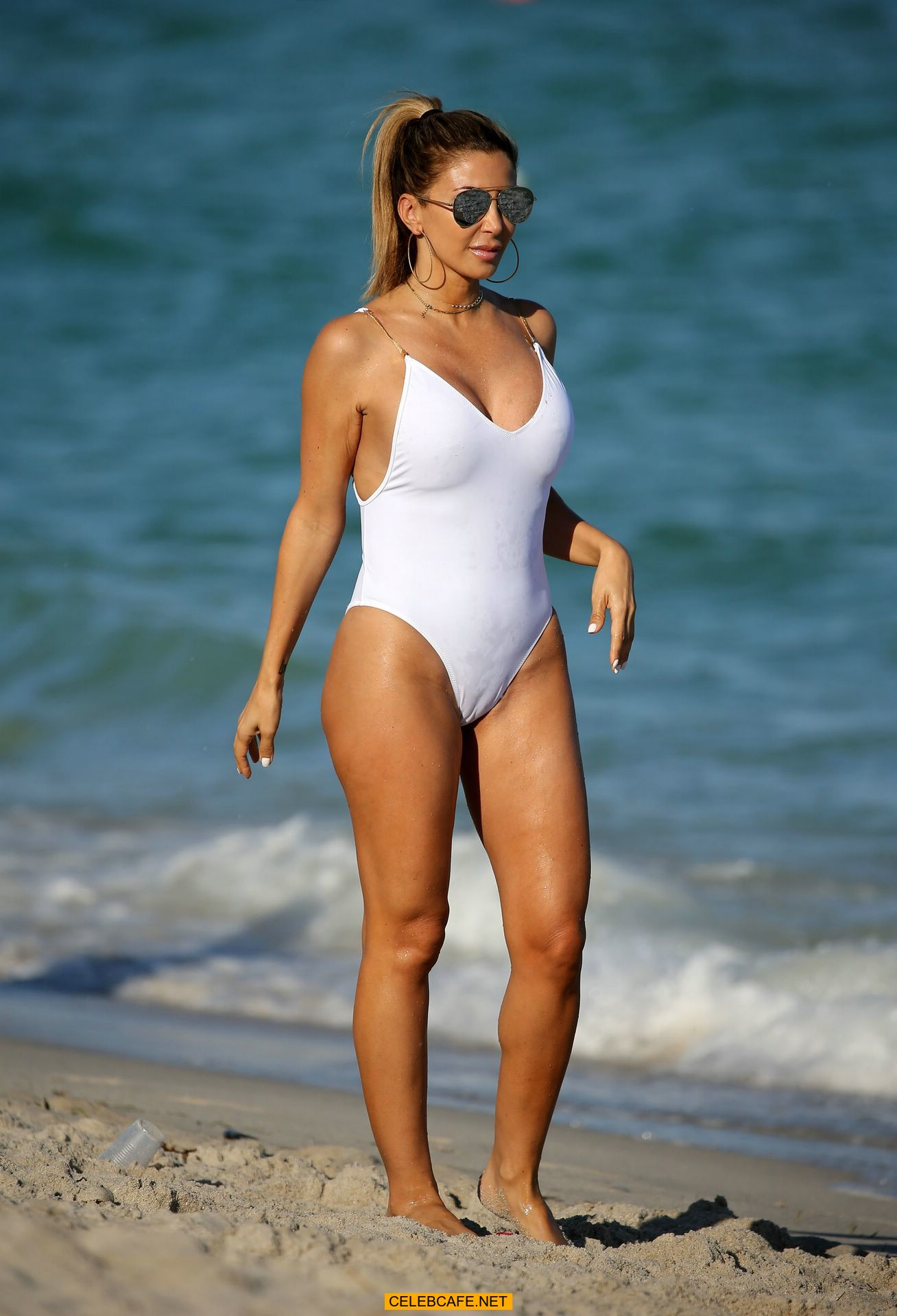 larsa pippen shows camel toe in a white swimsuit on the neach in miami