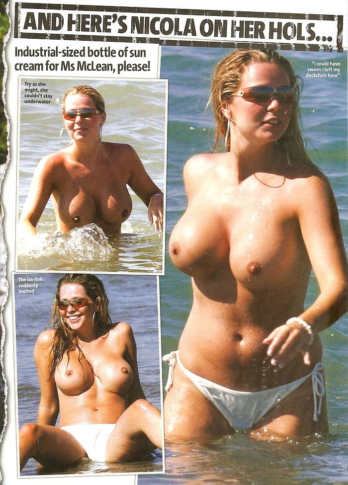 Busty Nicola McLean caught topless on a beach
