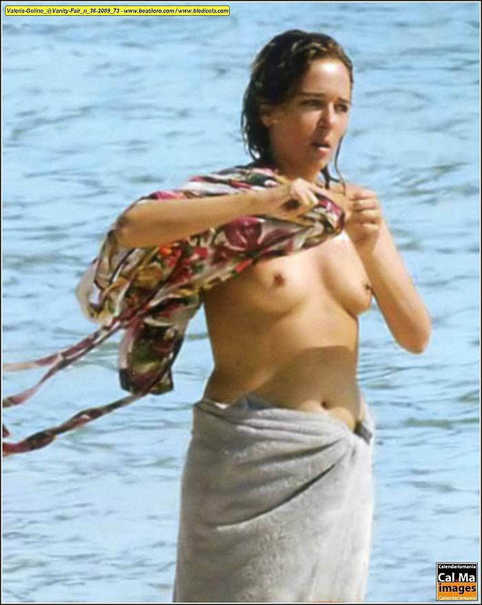 Valeria Golino caught topless on a beach
