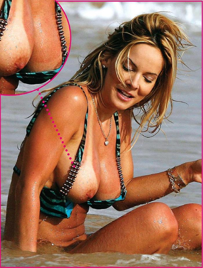Simona Fusco boob slip on a beach
