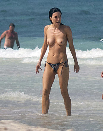 Jaime Murray caught topless at the beach in Mexico