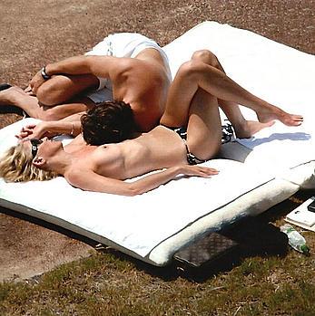 Sharon Stone sunbathing topless at Pantelleria