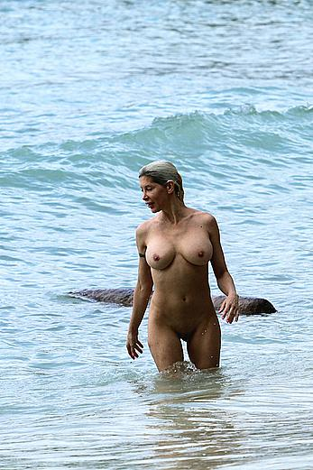Busty Angelique Morgan fully nude on a beach in Hawaii