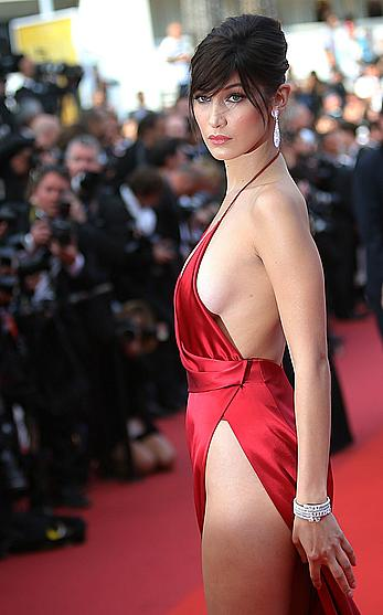 Bella Hadid sexy in red dresss at La fille inconnue premiere at 69th Annual Cannes Film Festival