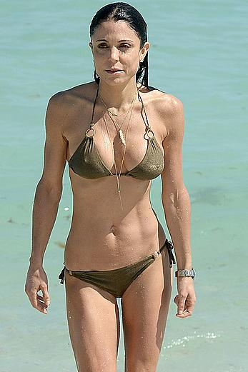 Bethenny Frankel wears a gold string bikini on the beach