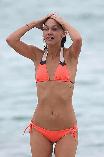 Brittany Gonzales in orange bikini on Miami Beach