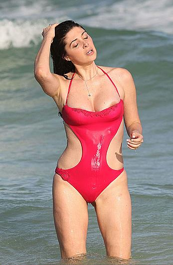 Brittny Gastineau nipple slip in red swimsuit on Miami beach