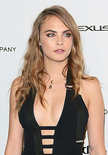 Cara Delevingne slight cleavage at Weinstein Company and Netflix 2015 Golden Globes After Party