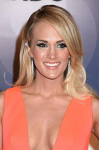 Carrie Underwood posing at 49th Annual CMA Awards in Nashville