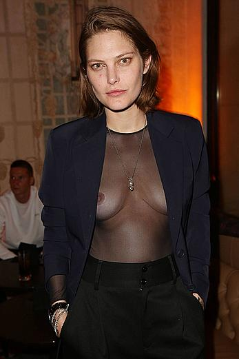 Catherine McNeil braless in see through top in Paris