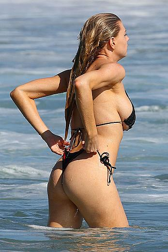 Charlotte McKinney side of boob and round ass in bikini on a beach in Malibu