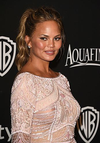 Chrissy Teigen in see through dress, shows nipples at InStyle And Warner Bros Golden Globes Party