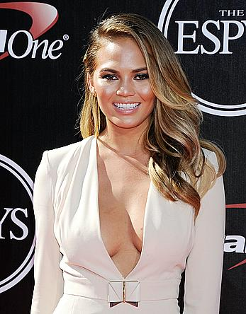 Chrissy Teigen without bra shows deep cleavage at ESPYS at Nokia Theatre
