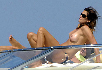 Cindy Crawford sunbathing topless on a yacht