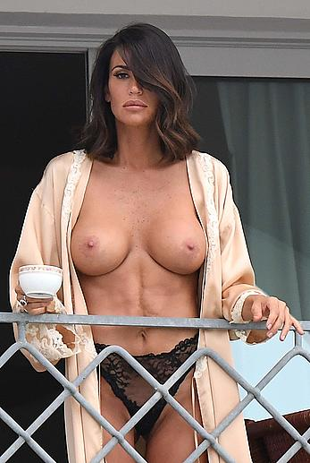 Claudia Galanti topless on her hotel balcony in Porto Cervo