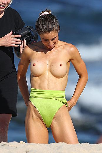 Claudia Jovanovski topless for a photoshoot on a beach in Sydney