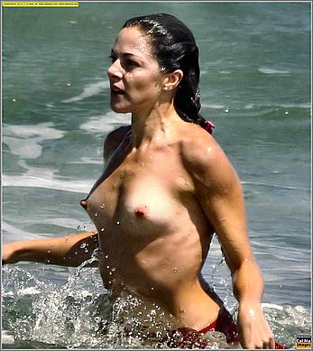 Claudia Gerini nude tits and ass paparazzi pics