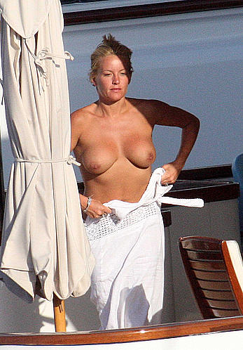 Blonde Davinia Taylor sunbathing topless in Italy