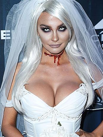 Emily Sears deep cleavage and legs at The 2016 Maxim Halloween party