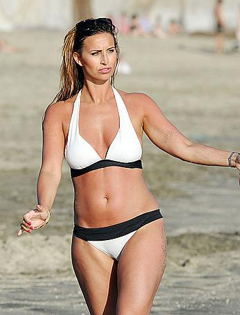 Ferne McCann sexy in white bikini on the beach while in Tenerife
