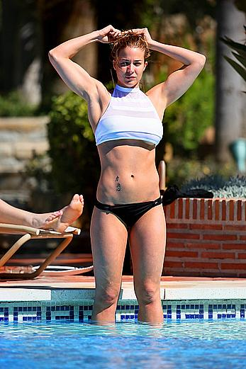Gemma Atkinson bottom of boob in bikini poolside in Marbella