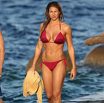 Busty Gemma Atkinson wearing a pink bikini at the beach
