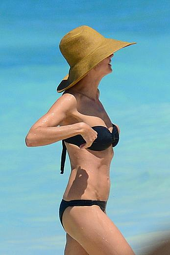 Heidi Klum wearing black bikini at a beach in the Bahamas