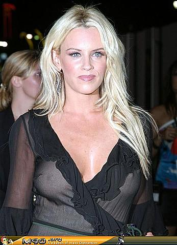 Blonde Jenny McCarthy posing in see through dress