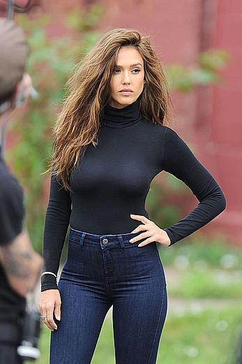 Jessica Alba in jeans and tight top on set of a photoshoot