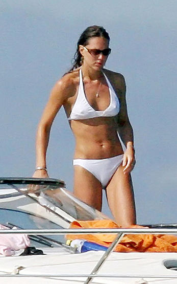 Kate Middleton in white bikini on a boat