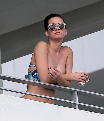 Katy Perry wearing a bikini top on a hotel balcony in Miami