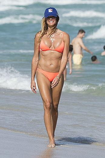 Kelly Bensimon in orange bikini at Miami beach